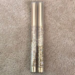 Sparkly gold candles with metallic tapers